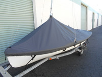 """420 sailboat Mast Up Peaked Cover made in America by skilled artisans at SLO Sail and Canvas. 1/4"""" shockcord is built into cover to secure your cover tightly around the boat's rubrail. Web Loops allow you to """"tent"""" your cover up to prevent pooling of water."""