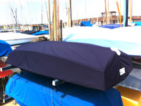 """Naples Sabot Sailboat Hull Cover made in America by skilled artisans at SLO Sail and Canvas. 1/4"""" shockcord is built into cover to secure your cover tightly around the boat's rubrail. All of our covers are patterned from the actual boats they are designed to fit. This make for a better, higher quality product."""