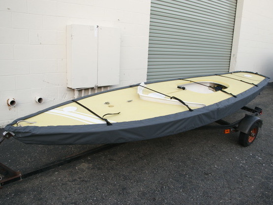 Scorpion Sailboat Hull Cover made in America by skilled artisans at SLO Sail and Canvas. Cover shown in Polyester Charcoal Gray. Available in 4 fabrics and many color choices.