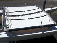 3pc Vinyl Trampoline to fit a XXX catamaran made in America by skilled artisans at SLO Sail and Canvas.