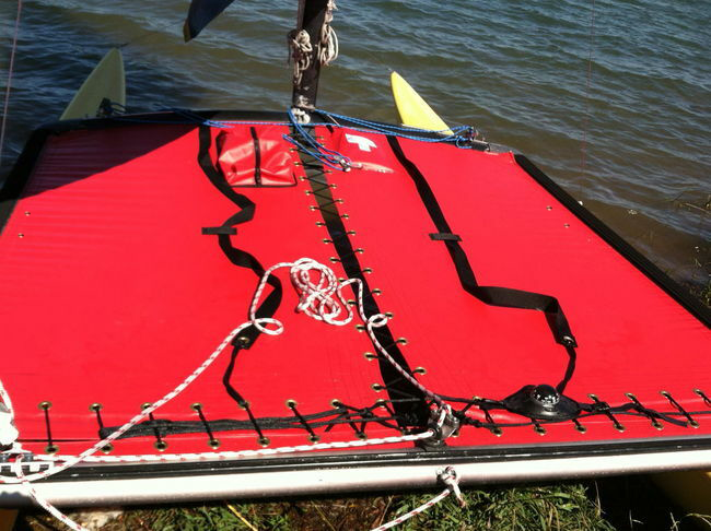 Trampoline to fit a Hobie® catamaran made in America by skilled artisans at SLO Sail and Canvas. Shown in Red 22oz Vinyl. ***OPTIONAL ZIPPER POCKET SHOWN.***