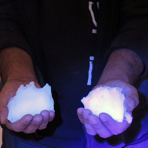Instant snow when exposed to a black light