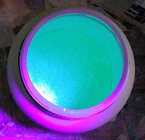 Green UV Black Light Powder exposed to blacklight source