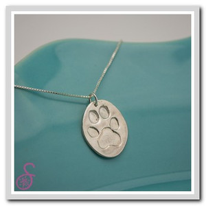 An oval-shaped Sterling Silver Pawprint Necklace