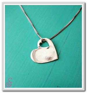 A single Sterling Silver Heart-in-Heart necklace