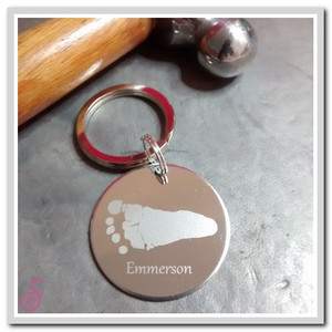 Stainless steel Circle Hand or Foot print keychain showing a single footprint