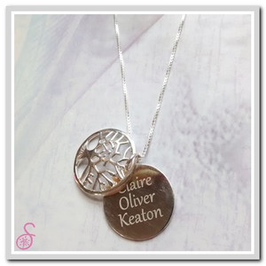 Sterling Silver Tree of Life Necklace in the open position, showing the names inside