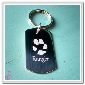 The front of the double paw print keychain. The back is the same design with the second pet's details