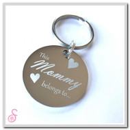 "The front of the stainless steel circular ""This Mommy belongs to..."" keychain"