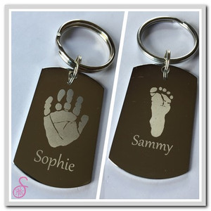 Front and reverse side of a Double Hand or Footprint Keychain showing one hand and one foot