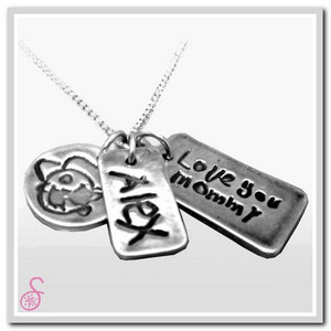 An example of one of our Art and Handwriting Sterling Silver necklaces