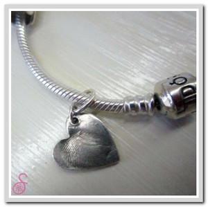 Sterling Silver fingerprint charm added to a charm bracelet (not sold)