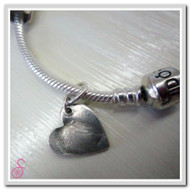Sterling Silver fingerprint charm added to a charm bracelet (not sold)