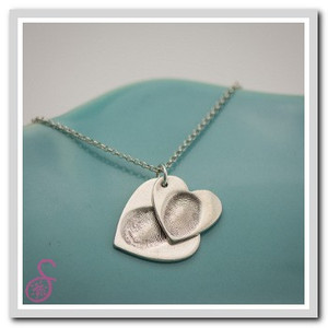 A double heart-shaped Sterling Silver fingerprint necklace
