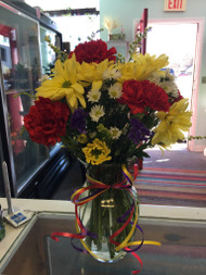 Long lasting red, yellow and White Daisies and Carnations all tied up with brightly colored curly ribbon is sure to be a crowd pleaser.