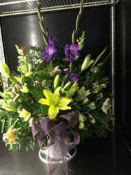 Pay tribute in a big way.  Yellow and purple glads and lilies make an impression they won't forget.