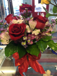 Our all time best seller featuring red roses, peruvian lilies and monte casino - all tied up with a bright red bow.