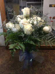 Subtle, calming, beautiful is this arrangement of one dozen long stemmed white roses garnished with lavender limonium and blue tulle