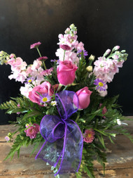 Lavender roses surrounded with beautifully scented stock with purple and lavender accents and bow