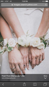 """Spray Roses accented with greens in bracelet form.  PICKUP ONLY!  To order upgraded bracelet - please select """"Premium"""" upgrade and note color choice, black, rose gold, white pearl, silver diamond, gold diamond. Please note time of pickup and color in notes."""