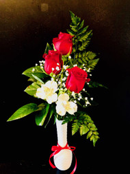 Say Merry Christms with 3 Red Roses in a bud vase, accented with peruvian lilies, greens and babies breath