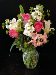 A delightful collection of roses, lilies, stock and peruvian lilies in pink and white - sure to please everyone on your list