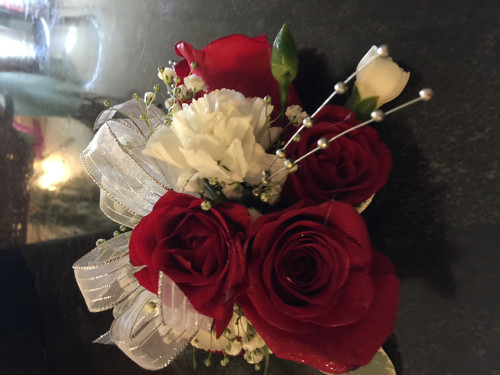 Luxurious full size roses combined with white mini carnations and accented withe ribbons and bling.  PICKUP ONLY.  For specialty wristbands, select upgrade.  State color preferences in comments.