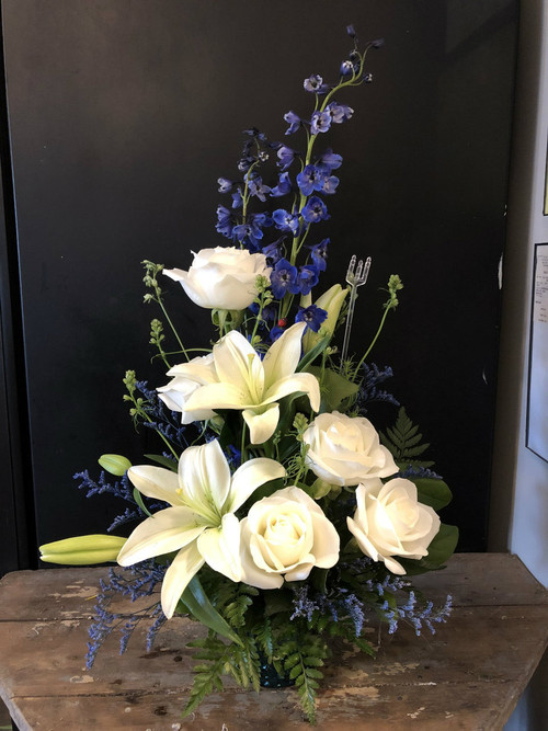 Dramatic and Pure display of Dark Blue Delphinium, white lilies and white roses