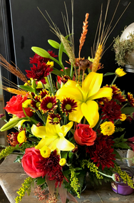 Brighten your world with lovely fall flavors of yellow, orange and burgundy, accented with seasonal wheat grasses