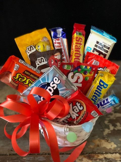 Don't want to send flowers, but want to brighten someone's day?  Give a basket stuffed full of sweet treats.  Awesome for school, birthdays,  just because.   Colors of basket and ribbon will vary.  Please note in comments if you have a preference.