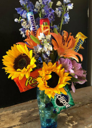Can't decide between flowers and candy?  How about both?  Great gift for just about anyone.  Seasonal flowers interspersed with selection of candies.  Preferences can be noted in comments section.  We can adjust for Christmas, Birthdays, Anniversaries, Graduations, etc, just let us know the occasion.  For larger arrangements, size up to Premium or Extra Premium.