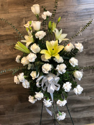 Send your respects in an elegant way with all white floral with a splash of yellow on a standing easel