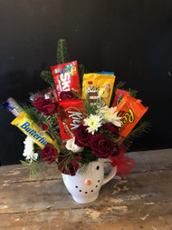 Spend a little - get a lot - christmas greens, flowers and candy - all nestled together in a Snowman keepsake mug