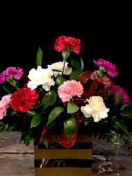 One Dozen Delightful Long Lasting Carnations arranged in an elegant Clear Rectangular Vase with Gold Stripes