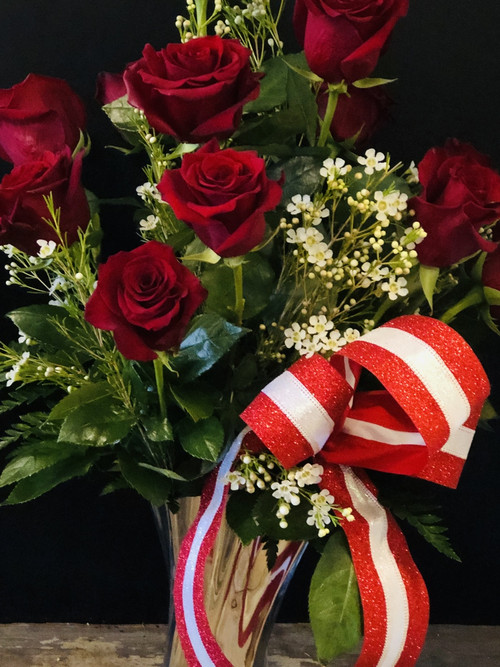 No one will feel unloved if they receive these long stemmed red roses in an absolutely exquisite silver keepsake vase.  The best statement!