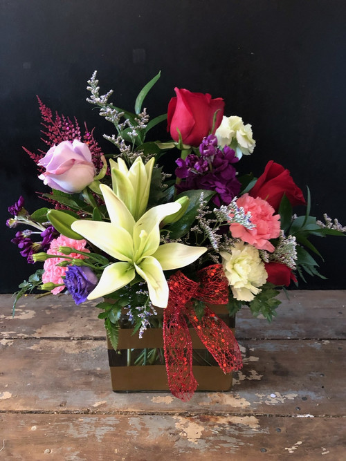 A luscious mix of lilies, roses, carnations and stock in valentine colors and accented with lavender limonium and babies breath.
