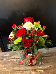 Your Christmas will be merry and bright with this mercury glass vase full of Red and green floral and topped with a plaid ribbon and jingle bells.