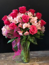 Oh my my!!  A full dozen premium hot pink roses surrounded with long lasting pink alstromeria and garnished with a pink heart shaped bow.  She'll fall in love all over again!