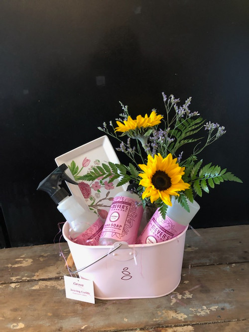 What better gift for Mother's Day than fresh sunflowers and Mrs Meyers trio - deliciously scented hand soap, dish soap and spray cleaner with a cherry blossoms tray to keep it on, all gifted together in a pink metal caddy?