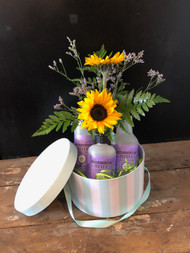 Surprise her with fresh bright sunflowers and Mrs Myers trio of soaps - hand, dish and spray, all gathered together in our collectible mint and white hat box.