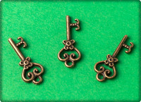 Scrolled Heart Key Charm - Antique Brass