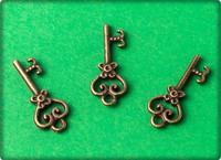 Scrolled Heart Key Charm - Antique Brass