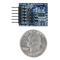 Size comparison product image of the Pmod ACL: 3-axis Accelerometer and a US quarter (diameter of quarter: 0.955 inches [24.26 mm]; width: 0.069 inches [1.75 mm]).