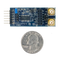 Size comparison product image of the Pmod AD5: 4-channel 4.8 kHz 24-bit A/D Converter and a US quarter (diameter of quarter: 0.955 inches [24.26 mm]; width: 0.069 inches [1.75 mm]).
