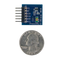 Size comparison product image of the Pmod ALS: Ambient Light Sensor and a US quarter (diameter of quarter: 0.955 inches [24.26 mm]; width: 0.069 inches [1.75 mm]).
