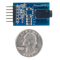 Size comparison product image of the Pmod AMP2: Audio Amplifier and a US quarter (diameter of quarter: 0.955 inches [24.26 mm]; width: 0.069 inches [1.75 mm]).