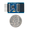 Size comparison product image of the Pmod DA4: Eight 12-bit D/A Outputs and a US quarter (diameter of quarter: 0.955 inches [24.26 mm]; width: 0.069 inches [1.75 mm]).