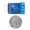 Size comparison product image of the Pmod HB3: H-bridge Driver with Feedback Inputs and a US quarter (diameter of quarter: 0.955 inches [24.26 mm]; width: 0.069 inches [1.75 mm]).