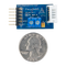 Size comparison product image of the Pmod HB5: H-bridge Driver with Feedback Inputs and a US quarter (diameter of quarter: 0.955 inches [24.26 mm]; width: 0.069 inches [1.75 mm]).