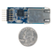 Size comparison product image of the Pmod NIC100: Network Interface Controller and a US quarter (diameter of quarter: 0.955 inches [24.26 mm]; width: 0.069 inches [1.75 mm]).